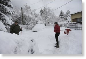 Sofia residents dig their cars out from the heavy snow in Sofia, Bulgaria