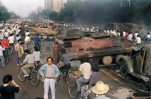 Torched armor vehicles near Tiananmen Square 1989