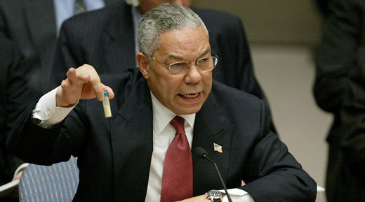 Colin Powell holds up a vial