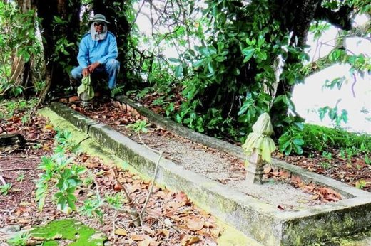 Giant skeleton in Malaysia: Mohd Fuad's assistant Azman Wahab at the large grave site in Pulau Upeh