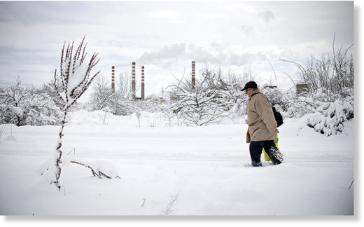 A man walks in a suburb of Sofia after heavy snowfall on January 7, 2017.