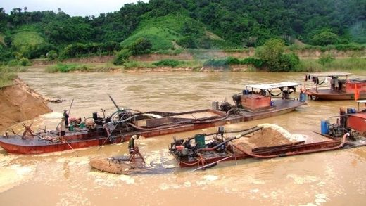Sand harvesting on river