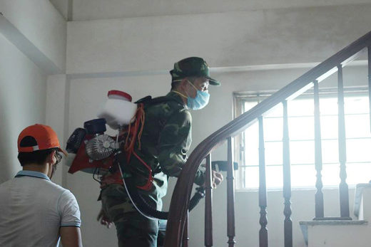 Vietnamese soldiers mobilized to eradicate mosquitos in dengue epidemic
