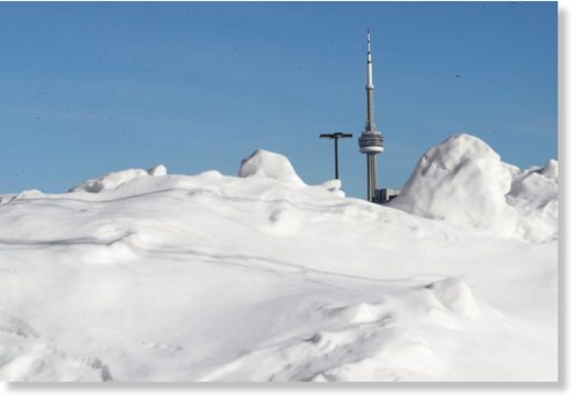 Snow piles up in parking lots at the Canadian National Exhibition as Toronto tries to stay warm in the extreme cold.