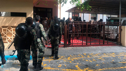 Security forces arrive at parliament in the Maldives