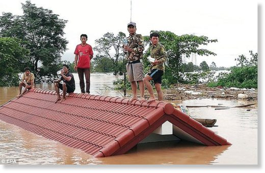 Many Lao villagers are stranded on the roofs of their homes after fleeing floodwaters caused by the Xe Pian Xe Nam Noy hydroelectric dam burst